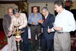 K C Thyagaraj lighting the lamp of hope and Prosperity. Family members K C Venugopal, K C RaviShanker, K. S. Malle Gowda are applauding the event.